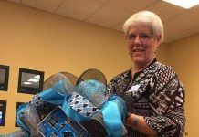 Andree West demonstrates how to show team spirit by making a Panthers wreath.