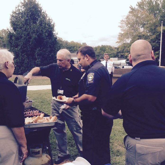 volunteers helping at a thank you BBQ for the police