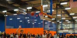 Christian Owens driving on a lay-up being fouled