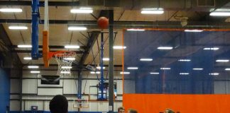 Khalil Chapman #20 and others hitting the boards