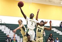 Robert Bonar (2) gets past two Pinecrest defenders and hits the lay up.